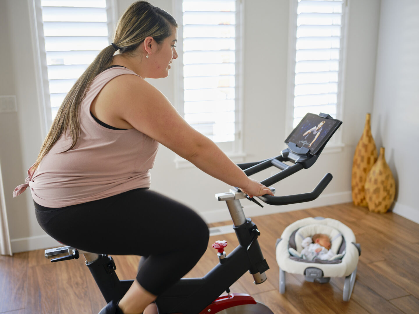 Mother on exercise bike